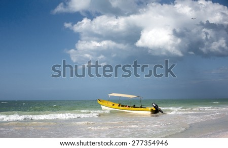 Boat under a cloudy blue sky - stock photo