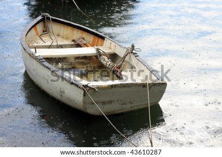 Boat Under the Rain - stock photo