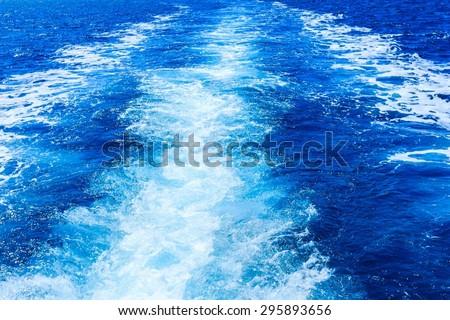 Boat wake prop wash on blue ocean, mediterranean sea. - stock photo