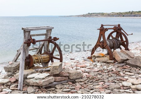 Boat winch on the beach  - stock photo
