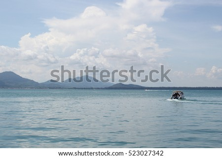 boat with blue sea and cloudy