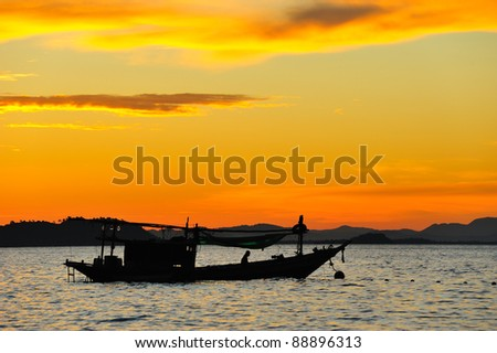 Boat with sunset - stock photo