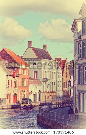 boat with tourists on channel, Bruges, Belgium - stock photo
