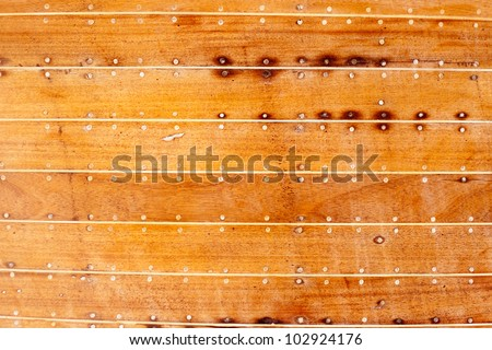 boat wooden hull texture detail with caulking putty and screw - stock photo