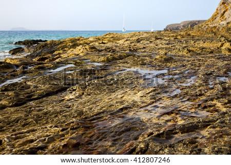 boat yacht in lanzarote  spain coastline rock beach  water  and summer  - stock photo