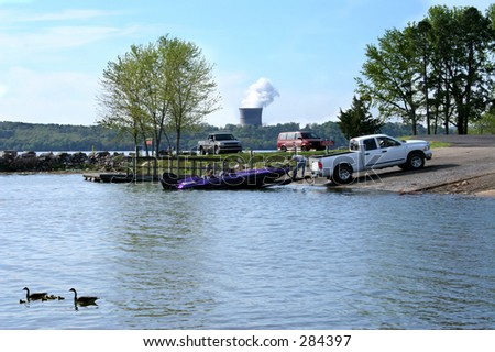 Boater pulling his boat from the arkansas river. - stock photo