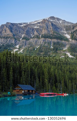 Boathouse and red canoes, Banff National Park, Canada - stock photo