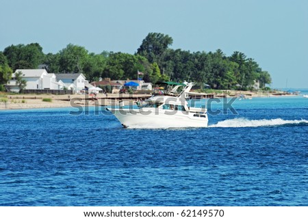 boating by the beach - stock photo