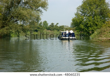 Boating on the river Great Ouse in Cambridgeshire - stock photo
