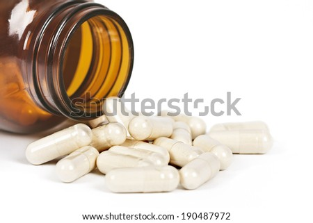 boating pills spilled on white background