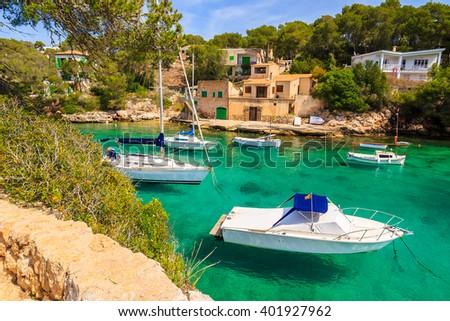 Boats anchored in beautiful bay near small fishing village of Cala Figuera on Majorca island, Spain - stock photo