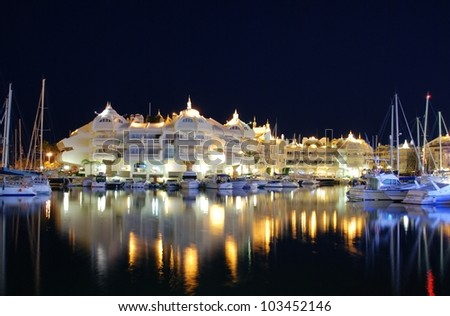 Boats and apartments in the marina at night, Benalmadena, Costa del Sol, Malaga, Province, Andalucia, Western Europe. - stock photo