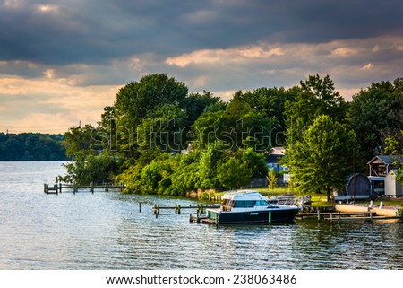 Boats and docks along the Back River in Essex, Maryland. - stock photo