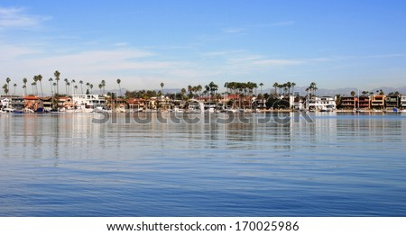Boats and houses on the shore of Naples Island, Long Beach, CA - stock photo
