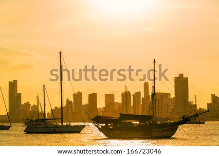 Boats and skyscrapers at sunset in Cartagena, Colombia - stock photo