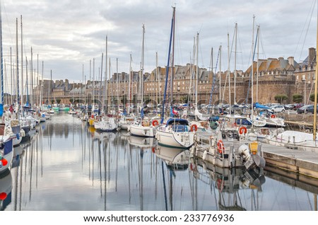 Boats and yachts in the port of historical city Saint Malo, Brittany, France - stock photo