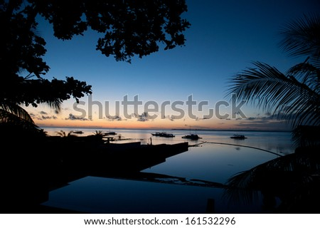 Boats are floating in the water with a horizon in the background. - stock photo