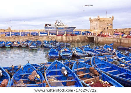 Boats at the harbor from Essaouria. Essaouria is the most popular Atlantic coast city in Morocco. - stock photo