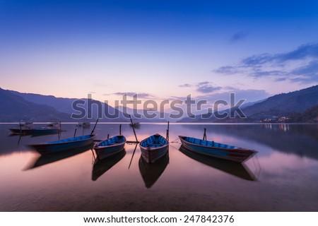 Boats at the Phewa lake in Pokhara, Nepal - stock photo