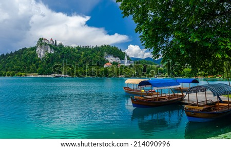 Boats at the pier that help one to trip to the island in the middle of the Bled lake and ringing the bell of the 17th century church. Slovenia.