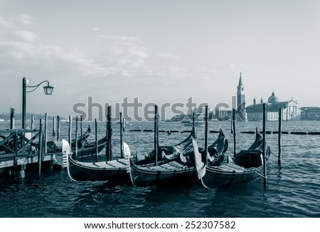 Boats by sea at Venice with church background, vintage