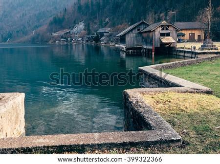 Boats dock on the mountain lake in Hallstatt, Austria - stock photo