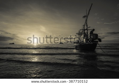 Boats docked during beautiful sunrise by the coasts of the island, edit warm tone
