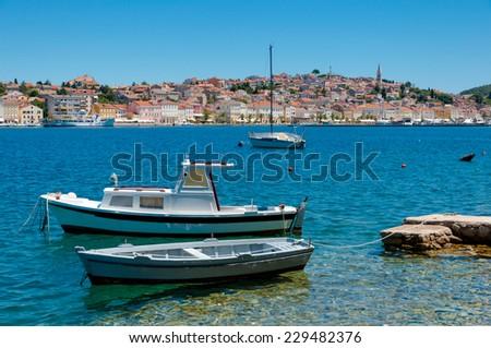 Boats docked in front of Mali Losinj in Croatia - stock photo