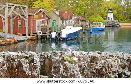 Boats docked in harbor of northeastern fishing town - stock photo