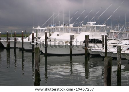 Boats docked in the harbor waiting for the storm to hit. - stock photo