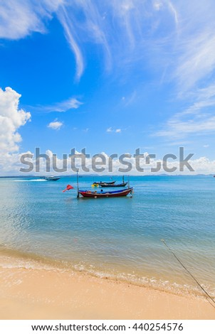 Boats floating on beach and blue sky with clouds Thailand