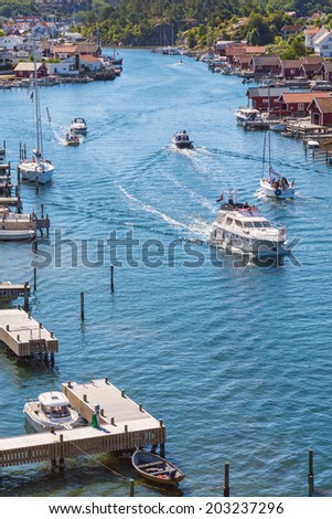 Boats in a canal on the coast - stock photo