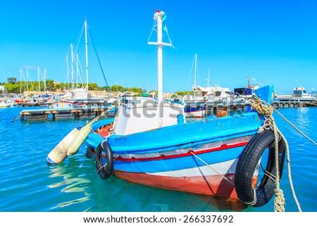 Boats in a port in San Vito Lo Capo, Sicily, Italy - stock photo