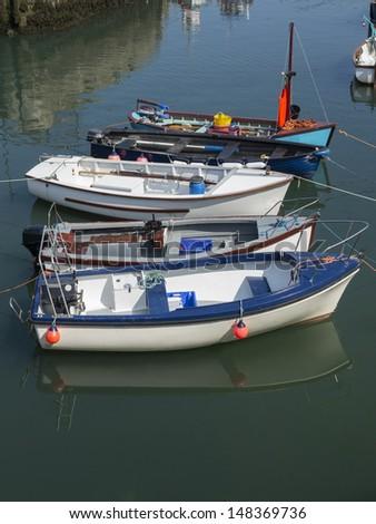 boats in annalong harbor ireland - stock photo
