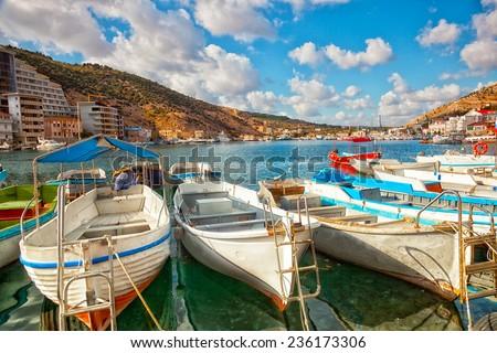 Boats in Balaklava Bay in the sunny summer day, the Crimea - stock photo