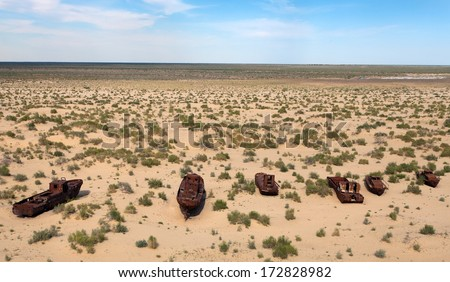 Boats in desert around Moynaq, Muynak or Moynoq - Aral sea or Aral lake - Uzbekistan - asia  - stock photo