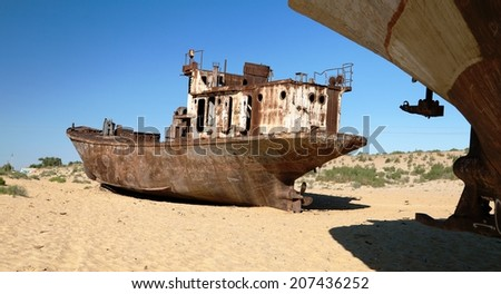 Boats in desert around Moynaq, Muynak or Moynoq - Aral sea or Aral lake - Uzbekistan - asia  - stock photo