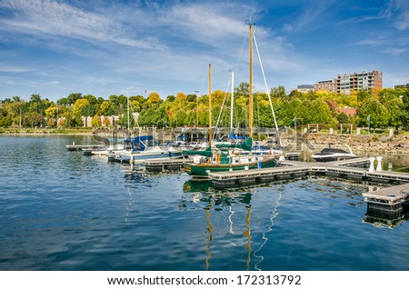 Boats in Harbour and Autumn Colours - stock photo