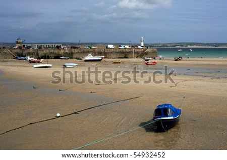 Boats in St Ives Harbour at low tide, Cornwall, England - stock photo