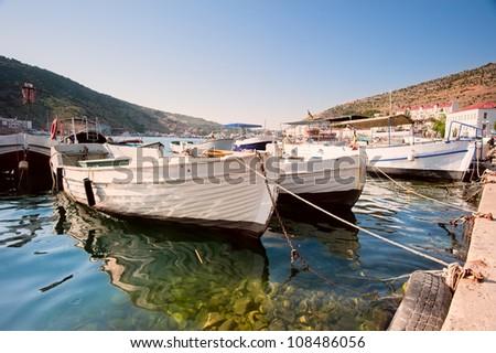 Boats in the harbor city Baloklava. Crimea - stock photo