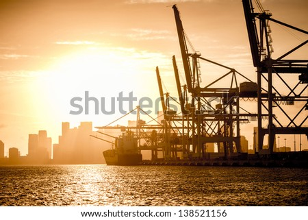 Boats in the port of Miami at sunset - stock photo