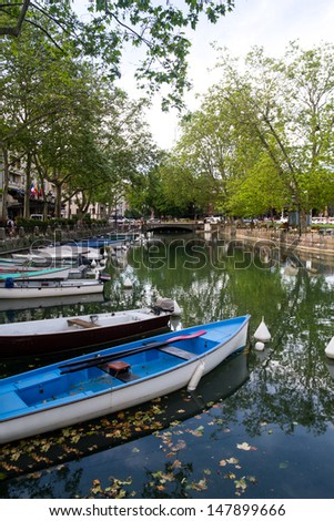 Boats line the Thiou Canal in Annecy during the Summer.