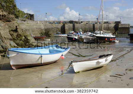 Boats moored and on beach at Newquay Harbour in Cornwall, England