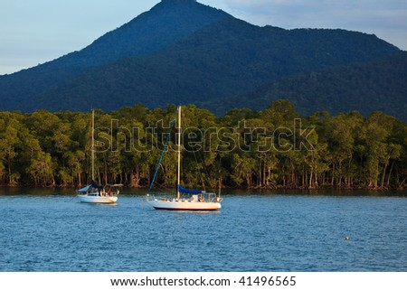 Boats Moored in Cairns Harbor Australia - stock photo