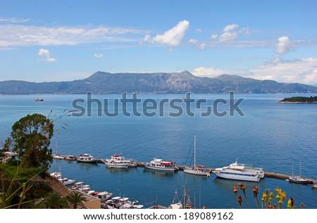 Boats moored in harbor in Kerkyra, Corfu, Greece - stock photo