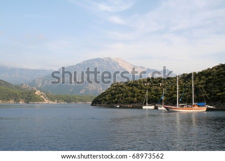 Boats moored off Saint Nicholas Island, Turkey. Mount Babadag is in the distance.