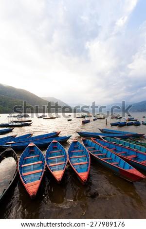 Boats on Fewa Lake, Pokhara Nepal - stock photo
