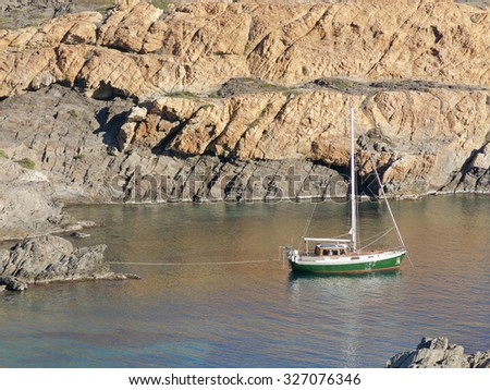 Boats on mediterranean bay. The Cap de Creus, a natural park, is ideal for excursions on foot or by boat. Situated in the northern Costa Brava, Girona province, Catalonia, Spain. - stock photo