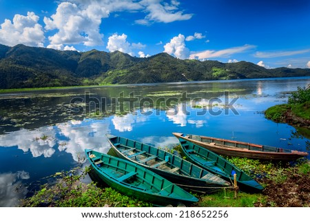 Boats on Pokhara Fewa Lake in Nepal - stock photo