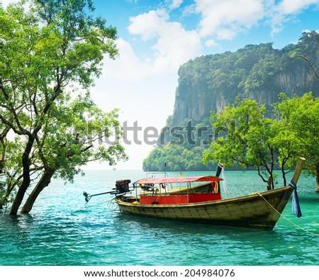 Boats on Railay beach, Thailand. - stock photo